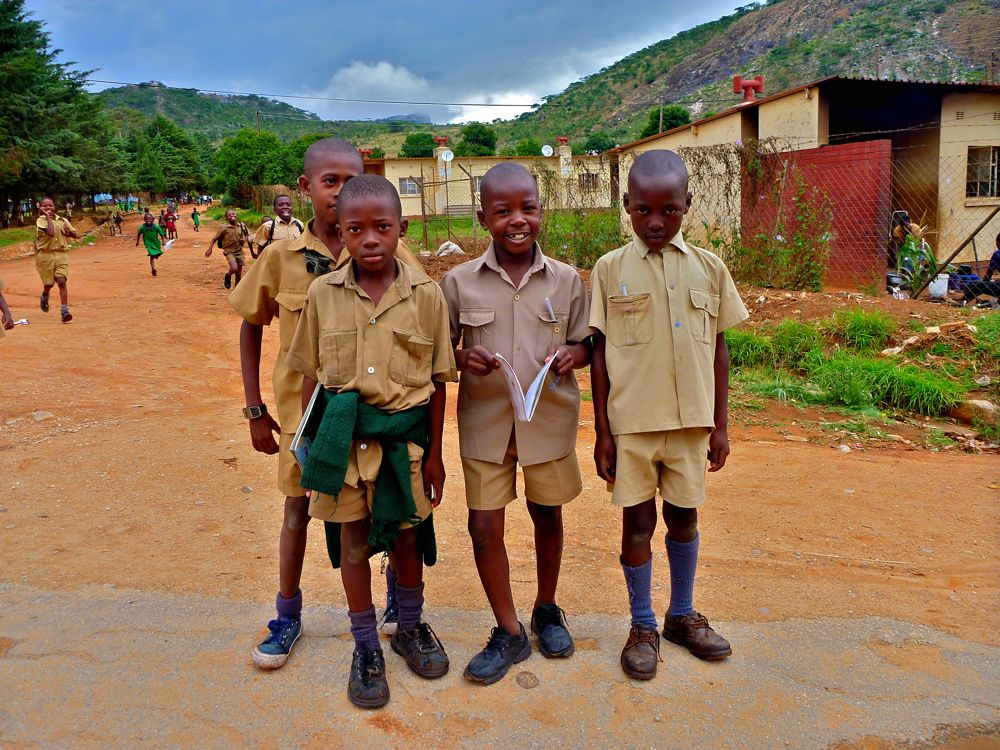 A group of boys who've just finished school in Nyanga, Zimbabwe.